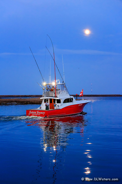 Twilight fishing boat at Wanchese on the Outer Banks of NC.