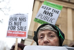 © licensed to London News Pictures. London, UK 17/03/2012. An elderly woman is at the UK Uncut demonstration against the Government's Health and Social Care Bill currently passing through Parliament, outside Department of Health, London. Photo credit: Tolga Akmen/LNP
