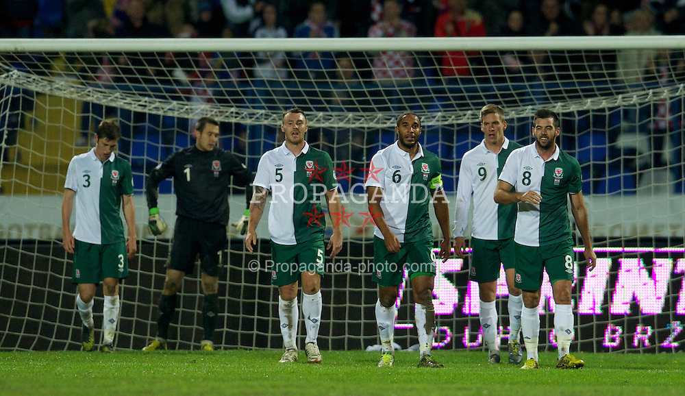 OSIJEK, CROATIA - Tuesday, October 16, 2012: Wales' goalkeeper Lewis Price, Darcy Blake, captain Ashley Williams, Steve Morison and Joe Ledley look dejected as Croatia score the second goal during the Brazil 2014 FIFA World Cup Qualifying Group A match at the Stadion Gradski Vrt. (Pic by David Rawcliffe/Propaganda)