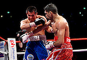 Blood sprays from the face of Marco Antonio Barrera as Amir Khan lands a right cross during the WBA and WBO Inter-Continental Lightweight title fight between Amir Khan and Marc Antonio Barrera at the MEN Arena on March 14, 2009 in Manchester, England.