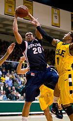 January 30, 2010; San Francisco, CA, USA;  Gonzaga Bulldogs forward Elias Harris (20) grabs a rebound from San Francisco Dons guard Kwame Vaughn (1) during the second half at the War Memorial Gym.  San Francisco defeated Gonzaga 81-77 in overtime.