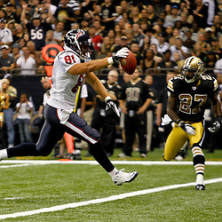 September 25, 2011; New Orleans, LA, USA; Houston Texans tight end Owen Daniels (81) runs in for a touchdown past New Orleans Saints safety Malcolm Jenkins (27) during the first quarter at the Louisiana Superdome. Mandatory Credit: Derick E. Hingle