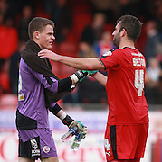 Crawley Town midfielder Simon Walton congratulates Crawley Town goalkeeper Callum Preston on his winning League debut during the Sky Bet League 2 match between Crawley Town and Leyton Orient at the Checkatrade.com Stadium, Crawley, England on 10 October 2015. Photo by Bennett Dean.