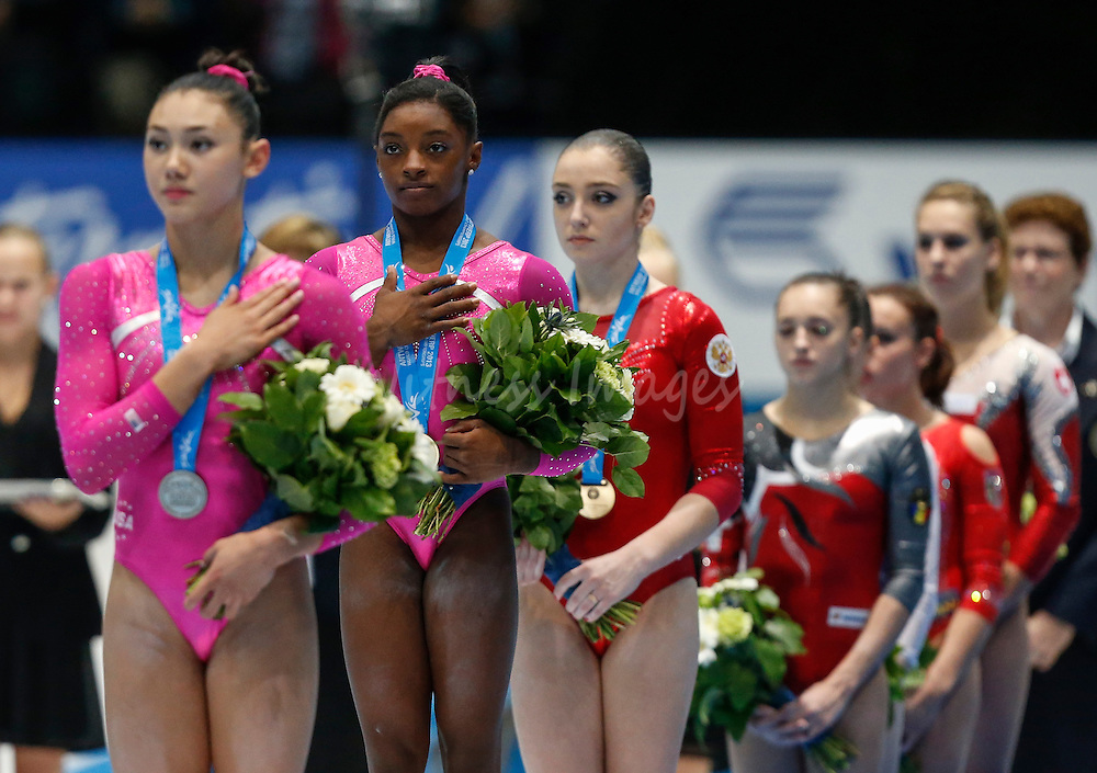 (from L-R) silver medalist Kyla Ross of the U.S., gold winner Simones Biles of the U.S. and Bronze medalist Aliya Mustafina of Russia listen to national anthems during the women's all around final at the Artistic Gymnastics World Championships in Antwerp, Belgium, 04 October 2013.