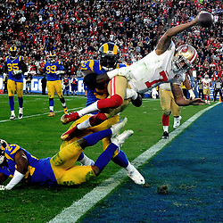 San Francisco 49ers quarterback Colin Kaepernick (7) dives for the two point conversion to give the 49ers the lead over the Los Angeles Rams in the fourth quarter of a NFL football game at the Los Angeles Memorial Coliseum on Saturday, Dec. 24, 2016 in Los Angeles. San Francisco 49ers won 22-21.