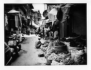 Crowded spice bazaar contrasts with the eerily empty streets of  photograph# 11, Srinagar, Indian Administered Kashmir.