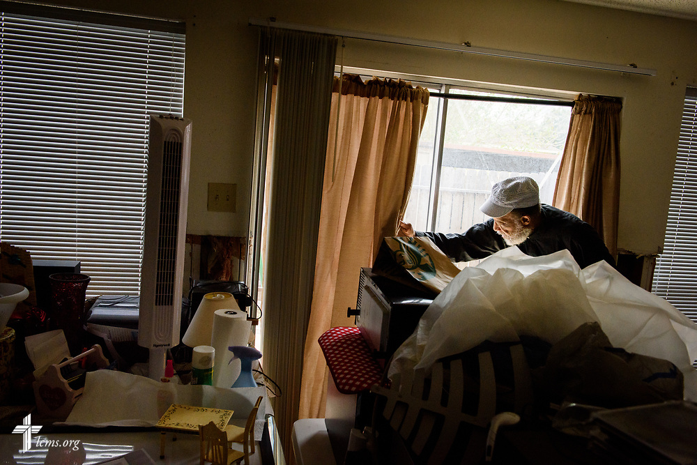 An LCMS pastor navigates through his flood-damaged apartment following Hurricane Harvey on Tuesday, Sept. 26, 2017, in Houston. LCMS Communications/Erik M. Lunsford