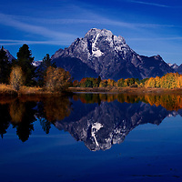 Fall foliage reflected in lake near Mount Moran Grand Tetons National Park, Wyoming