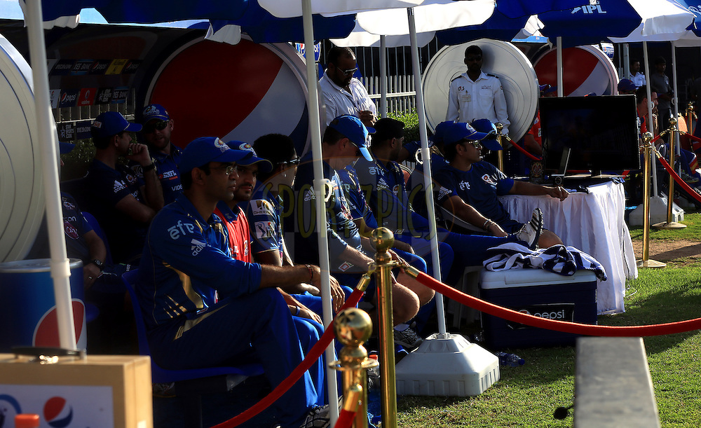 Mumbai Indians Team members in dugout during match 16 of the Pepsi Indian Premier League 2014 between the Delhi Daredevils and the Mumbai Indians held at the Sharjah Cricket Stadium, Sharjah, United Arab Emirates on the 27th April 2014<br /> <br /> Photo by Sandeep Shetty / IPL / SPORTZPICS