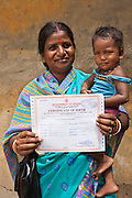 A mother and daughter in Cuttack, have just received her birth certificates from the Urban Law Centre run by the organisation CLAP. Committee for Legal Aid to Poor (CLAP), helps provide legal aid to the poorer communities in the Orissa district of India.