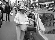 Maureen Potter with The Dublin Fire Brigade..1986..19.07.1986..07.19.1986..19th July 1986..Dublin Fire Brigade aided and abetted by Maureen Potter staged a collection,today,in aid of The Royal Victoria Eye and Ear Hospital,Adelaide Road,Dublin. It is hoped that the proceeds would go towards the purchase of a laser eye scanner. The Eye and Ear Hospital was established in 1897 and has served not only Dublin but the whole country as well...Even the Gardai had to dig deep! Image shows that Maureen even made the Gardai donate to what is a very worthy collection.