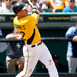 March 22, 2012; Bradenton, FL, USA; Pittsburgh Pirates shortstop Clint Barmes (12) hits a fly out against the Tampa Bay Rays during the bottom of the third inning of a spring training game at McKechnie Field. Mandatory Credit: Derick E. Hingle-US PRESSWIRE