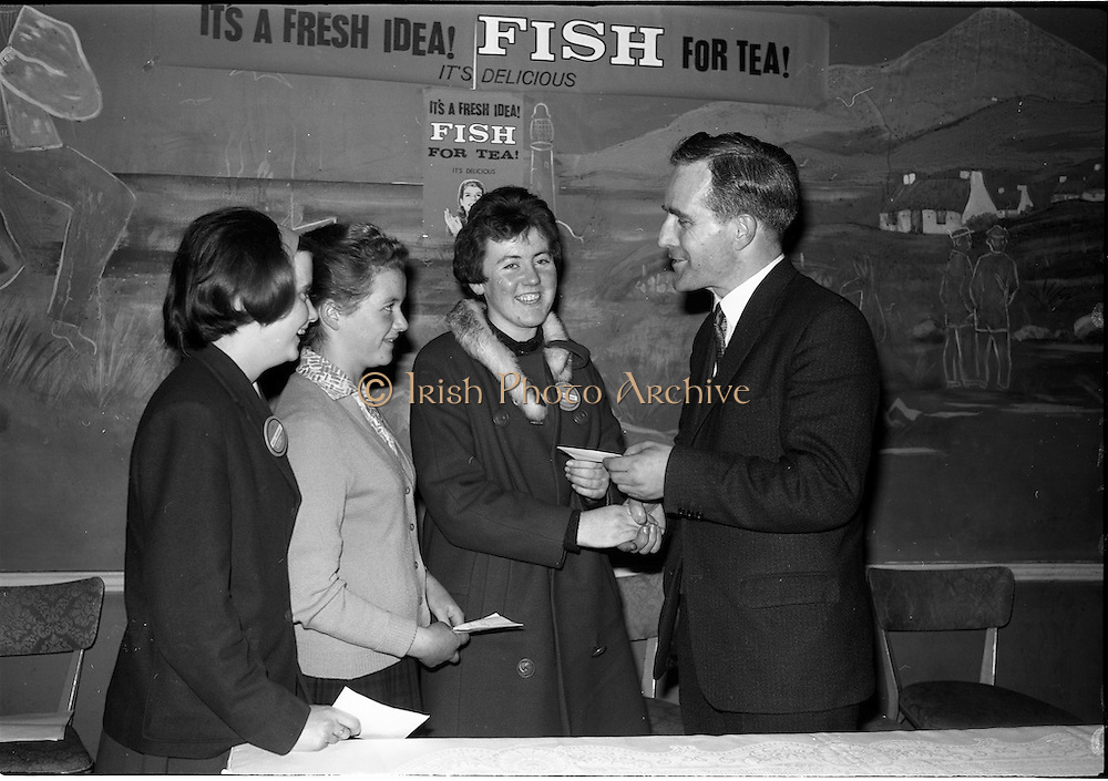 03-04/03/1964<br /> 03/03-04/1964<br /> 03-04 March 1964<br /> B.I.M. Fish Cookery Competition, Munster final, winners at the Metropole Hotel, Cork. The competition was held at the School of Commerce Cork. Photo Shows: Mr. T.F. Geoghegan, Market Development Manager, B.I.M., presenting the awards to (l-r): Philomena Kelleher, Ursuline Convent, Thurles (2nd); Maisie Galvin (3rd) Vocational School, Killorglin and Phyllis Cliffe, (1st) Vocational School, Dungarvan.