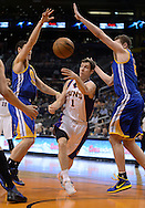 Apr 5, 2013; Phoenix, AZ, USA; Phoenix Suns guard Goran Dragic (1) passes the ball in traffic against the Golden State Warriors in the second half at US Airways Center. The Warriors defeated the Suns 111-107. Mandatory Credit: Jennifer Stewart-USA TODAY Sports