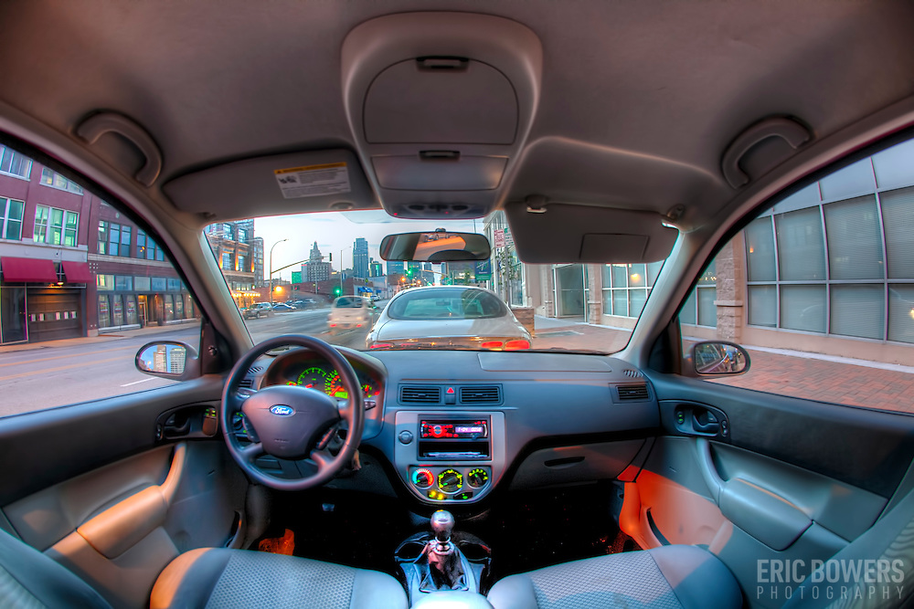 In the back seat of my car with my fisheye lens looking toward the Kansas City skyline from near 20th and Grand, downtown Kansas City, Missouri.