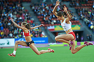 (R) Anna Jagaciak of Poland competes in women's triple jump qualification during the Second Day of the European Athletics Championships Zurich 2014 at Letzigrund Stadium in Zurich, Switzerland.<br /> <br /> Switzerland, Zurich, August 13, 2014<br /> <br /> Picture also available in RAW (NEF) or TIFF format on special request.<br /> <br /> For editorial use only. Any commercial or promotional use requires permission.<br /> <br /> Photo by © Adam Nurkiewicz / Mediasport