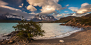 Evening light and windcloud, Lago Pehoe, Cuernos del Paine above, Parque Nacional Torres del Paine, Patagonia, Chile.