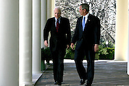 President George W. Bush and Republican Presidential nominee Senator John McCain R-AZ walk out of the Oval Office to a press conference in the Rose Garden of the White House on March 5, 2008.  Photograph: Dennis Brack