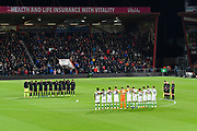 The players on the pitch and fans observe a minutes silence for Leicester City chairman Vichai Srivaddhanaprabha and the other crew and passengers who died in the helicopter crash on Saturday before the EFL Cup 4th round match between Bournemouth and Norwich City at the Vitality Stadium, Bournemouth, England on 30 October 2018.