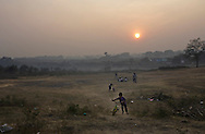 Children play near coal waste dumping site in Dhanbad, Jharkhand, India on Dec 5, 2014.<br /> (Photo by Kuni Takahashi)