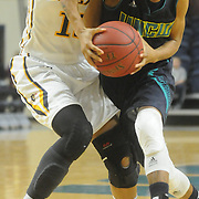 UNCW's Kelva Atkins drives on Drexel's Carrie Alexander Sunday February 1, 2015 at Trask Coliseum on the campus of UNCW. (Jason A. Frizzelle)