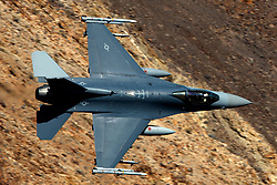 United States Air Force General Dynamics F-16C Fighting Falcon (88-0438) from the South Dakota Air National Guard flies low level through the Jedi Transition, Star Wars Canyon, Death Valley National Park, California, United States of America