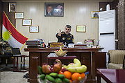"KURDISTAN, NORTHERN IRAQ, Dokuk.<br /> Qalubna Ma'Kum Feature:<br /> Qalubna Ma'kum (meaning ""Our hearts are With You"") are a group of foreign volunteer fighters who have joined up with the Peshmerga in Kurdistan to help with the battle against Daesh, also known as ISIS. <br /> <br /> Pictured: Deputy Commander Tariq Jaf in his office."