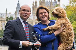 London, October 26 2017. Lord Gardiner poses with Maria Miller MP and her Cocker Spaniel/Poodle cross Ted who took third place at the annual Kennel Club and Dogs Trust Westminster Dog Of The Year competition that sees MPs and members of the House of Lords with their dogs as well as rescue dogs from the Dogs Trust. © Paul Davey