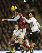 Picture by David Horn/Focus Images Ltd +44 7545 970036.30/01/2013.Bryan Ruiz (right) of Fulham is beaten to the ball by Joey O'Brien (left) of West Ham United during the Barclays Premier League match at Craven Cottage, London.
