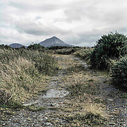 As a young boy, Martin Gallagher was abused on this boreen in Gortahork by Fr. Eugene Greene, an alcoholic priest who allowed boys to drive his car so he could sexually molest them at the wheel. One of Ireland's most prolific child abusers, Green was sentenced in 2000 to twelve years in prison for abusing twenty-six boys over a twenty-year period.