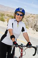 Senior woman with bike