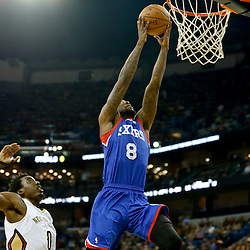 Nov 16, 2013; New Orleans, LA, USA; Philadelphia 76ers shooting guard Tony Wroten (8) shoots over New Orleans Pelicans small forward Al-Farouq Aminu (0) during the first quarter of a game at New Orleans Arena. Mandatory Credit: Derick E. Hingle-USA TODAY Sports