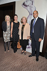 Left to right, ALISON YOUNG QVC presenter, SANDRA HOUGHTON senior beauty buyer at QVC UK, LORNA McKAY of QVC UK and STEVE BRIDGEMAN Chief Merchandising Officer at QVC at the Cosmetic Executive Women (CEW) UK Beauty Awards 2012 held at the Intercontinental Hotel, Hamilton Place, London on 27th March 2012.