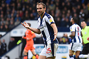 West Bromwich Albion defender Craig Dawson (25) queries a decision during the EFL Sky Bet Championship match between West Bromwich Albion and Millwall at The Hawthorns, West Bromwich, England on 22 September 2018.