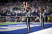 A pair of NFL officials signal that a fourth quarter extra point attempt is good for a 24-14 fourth quarter Dallas Cowboys lead during the NFL football NFC wild card playoff game against the Seattle Seahawks on Saturday, Jan. 5, 2019 in Arlington, Tex. The Cowboys won the game 24-22. (©Paul Anthony Spinelli)