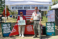 Marines give Free Hugs at the Marine Corps League's booth collecting donations for veterans, at the Antique Auto Show on the farmhouse grounds of Queens County Farm Museum.