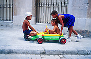 25 JULY 2002 - HAVANA, HAVANA, CUBA: Child play with a toy car near Plaza Vieja in the old section of Havana, Cuba, July 25, 2002..PHOTO BY JACK KURTZ