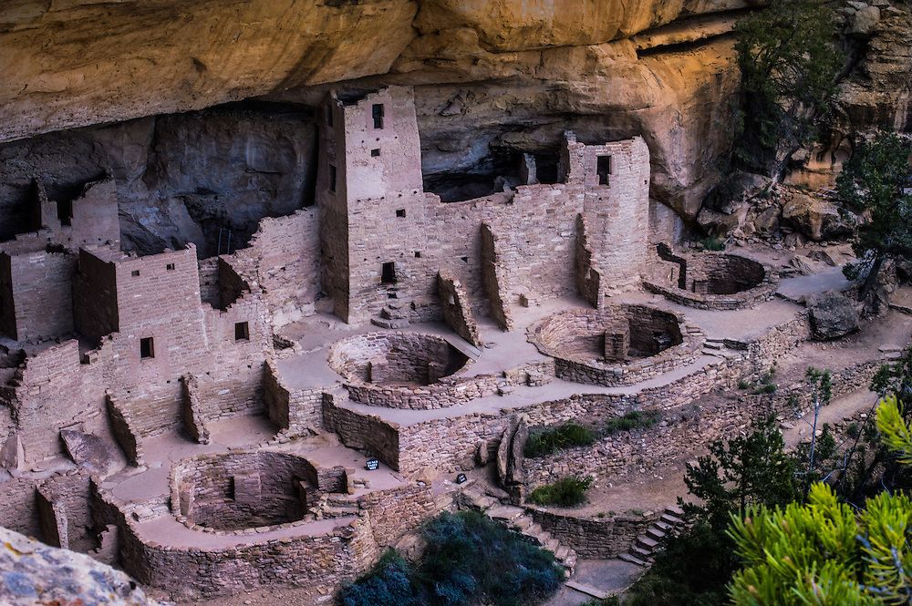 Mesa Verde National Park is in southwest Colorado. It's known for its well-preserved Ancestral Puebloan cliff dwellings, notably the huge Cliff Palace. The Chapin Mesa Archeological Museum has exhibits on the ancient Native American culture. Mesa Top Loop Road winds past archaeological sites and overlooks, including Sun Point Overlook with panoramic canyon views. Petroglyph Point Trail has several rock carvings.
