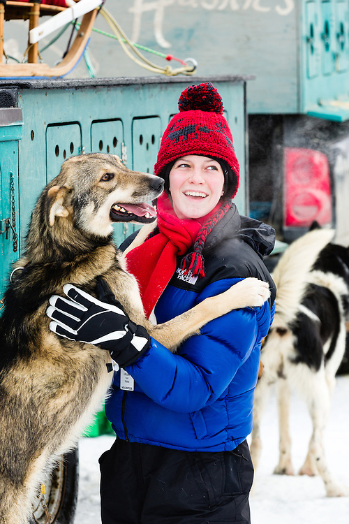Handler and dog share a tender moment before the restart of the 41st Iditarod Trail Sled Dog Race on Willow Lake in Southcentral Alaska.  Afternoon.