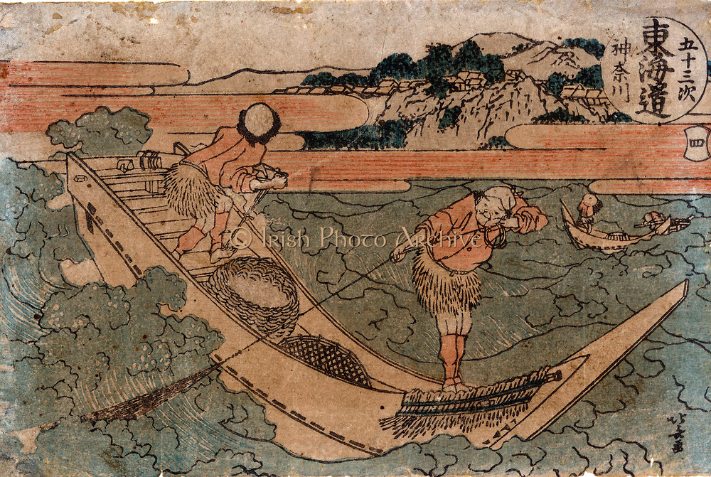 Fishermen in an open boat, one fishig with a net, the other controlling the boat with the rudder. In the boat baskets are ready to receive the catch. Katsushika Hokusai (1760-1849)  Japanese  Ukiyo-e artist.