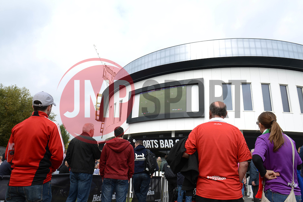 Fans look on at the big screen outside the Sports Bar and Grill - Mandatory byline: Dougie Allward/JMP - 07966 386802 - 03/10/2015 - FOOTBALL - Ashton Gate - Bristol, England - Bristol City v MK Dons - Sky Bet Championship