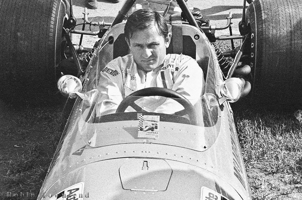 New Zealander Bruce MaClaren inside his car in the pits before the training session during the 1969 Spanish Grand Prix at the Montjuïc urban circuit in Barcelona, Spain.