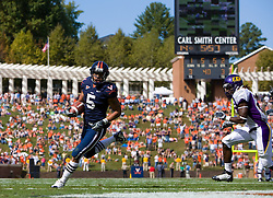 Virginia running back Mikell Simpson (5) beats East Carolina defensive back Dekota Marshall (23) to the end zone to score a rushing touchdown.  The Virginia Cavaliers defeated the East Carolina Pirates 35-20 in NCAA football at Scott Stadium on the Grounds of the University of Virginia in Charlottesville, VA on October 11, 2008.