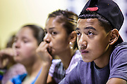 "18 AUGUST 2012 - PHOENIX, AZ: Young people who hope to be granted ""deferred action"" status listen to speakers at a deferred action workshop in Phoenix. More than 1000 people attended a series of 90 minute workshops in Phoenix Saturday on the ""deferred action"" announced by President Obama in June. Under the plan, young people brought to the US without papers, would under certain circumstances, not be subject to deportation. The plan mirrors some aspects the DREAM Act (acronym for Development, Relief, and Education for Alien Minors), that immigration advocates have sought for years. The workshops were sponsored by No DREAM Deferred Coalition.  PHOTO BY JACK KURTZ"