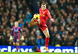 MANCHESTER, ENGLAND - Boxing Day Thursday, December 26, 2013: Liverpool's Joe Allen in action against Manchester City during the Premiership match at the City of Manchester Stadium. (Pic by David Rawcliffe/Propaganda)