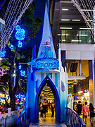 "12 DECEMBER 2018 - SINGAPORE:  The castle from ""Frozen"" in a Christmas display on Orchard Road. Orchard Road is the main shopping district of Singapore and for years hosts a large light display around Christmas. The main sponsor of this year's display is the Disney Company and the displays are decorated with characters from the Disney entertainment universe. This has upset some religious leaders in Singapore and the National Council of Churches of Singapore (NCCS) sent a letter to the Singapore Tourism Board (STB) expressing its concern about the ""increasing secularisation and commercialization of Christmas"" in Singapore. The STB reached out to the NCCS, but the Orchard Road lights will remain on through the holidays.   PHOTO BY JACK KURTZ"