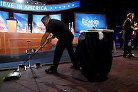 A worker at the Boston Convention and Exposition center cleans the carpets after Mitt Romney gave his concession speech at the Mitt Romney election headquarters in Boston on November 6, 2012. UPI/Matthew Healey