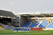 Both teams observe a minute's silence during the Capital One Cup match between Peterborough United and Crawley Town at London Road, Peterborough, England on 11 August 2015. Photo by Michael Hulf.