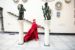 Image ©Licensed to i-Images Picture Agency. 10/07/2014. London, United Kingdom. The V&A is temporarily exhibiting the Angels created by Florentine sculptor Benedetto da Rovezzano between 1524 and 1529 for fundraising.<br /> In the image : Paul Jesson who plays Cardinal Wolsey in the RSC stage adaptions of Hilary Mantel's 'Wolf Hall' and Bring up the Bodies' with the Angels. Victoria & Albert Museum. Picture by i-Images