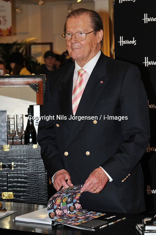 Sir Roger Moore book signing. English actor who portrayed James Bond from 1973 to 1985 signs copies of his new anthology Bond on Bond, published to coincide with the release of the new Bond film  Skyfall this month and to mark the franchise's 50th anniversary. Features over 400 photographs and insights into filming. Harrods, London,  United Kingdom, October 11, 2012. Photo by Nils Jorgensen / i-Images.
